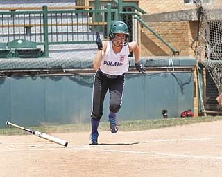 Kat Wilson drops her bat and runs for first after hitting.