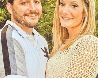 Jason Peretti and Danielle Ellenis