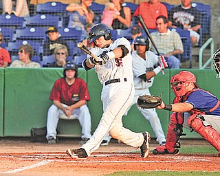 Scrappers batter Jeremy Lucas drives the ball to the outfield during Wednesday's game against Auburn at Eastwood Field. Among those watching are Doubledays catcher Spencer Kieboom and umpire Mike Wiseman.