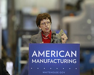 ROBERT K. YOSAY  | THE VINDICATOR..Rebecca Blank holds up a piece of metal used to check pressure in an apparatus - a 30 Million dollar grant for a manufacturing hub was announced today at M7 Technologies - .Obama officials, including White House National Economic Council Director Gene Sperling, Acting U.S. Commerce Secretary Rebecca Blank, Under Secretary of Defense Frank Kendall and a host of other manufacturing officials will be at M-7 Technologies.. - -30-..