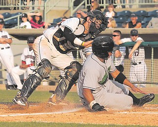 Scrappers catcher Jeremy Lucas tags out Jamestown's Jesus Solorzano on a throw from third baseman Erik Gonzalez during the seventh inning.