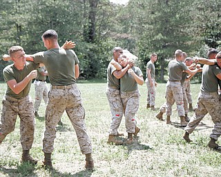 Marines Chad Corbin and Ian Evans participate in MCMAP, Marine Corps Martial Arts Program, to learn how to defend themselves and take aggressors down.