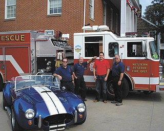 From left are Poland firefighters Tim Clavin and Sonny Chinowth, Poland Rotarian Matt Bodine and firefighter Dave Chapman with one of the cars that will be featured at the third annual Poland Rotary Car and Bike Show. The 2012 edition of the show will take place from 6 to 9 p.m. Wednesday at Poland United Methodist Church, 1940 Boardman-Poland Road. Antique and muscle cars as well as custom motorcycles will be part of the show. A basket raffle, 50-50 raffle, music and food will round out the activities. Proceeds will help Poland Firemen's Association purchase additional emergency equipment for pediatric patients needed because of the specialized nature of dealing with infants and small children. A grant from Rotary International Foundation also will be used for this project. For information call Matt Bodine at 330-702-8100 or email matt@bodineperry.com.