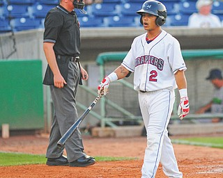The Scrappers' Aaron Siliga walks off the field after striking out on his second at-bat during Monday's baseball game against the Jamestown Jammers at Eastwood Field in Niles. Mahoning Valley managed only four hits in the 8-4 loss.