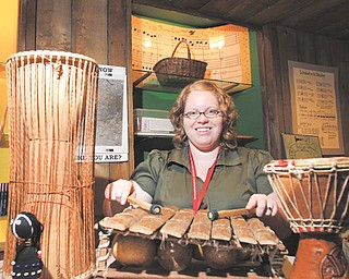 Traci Manning, curator of education at the Arms Family Museum on Wick Avenue in Youngstown, demonstrated African musical instruments in the hands-on portion of the museum during an open house for teachers Tuesday.