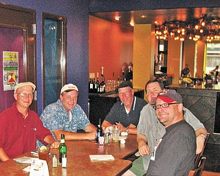 The Burger Guyz, along with Viking Jim (in the Indians cap), take in the eclectic atmosphere at the Lemon Grove's new location.