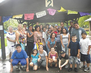 The Hispanic community in western Pennsylvania and eastern Ohio recently celebrated its 11th annual picnic at Pearson Park in New Castle. More than 60 people attended this reunion, which is organized every year by the Rev. Hope Cummins of Iglesia Latina  Emmanuel and Wayside Emmanuel Church; and Paulina Montaldo, a Spanish professor at Youngstown State University. People from Chile, Ecuador, Peru, Colombia, Dominican Republic, Cosa Rica, El Salvador and Mexico, along with Americans who like to practice their Spanish and learn about other cultures, attended the picnic. Paz Costello from the Crisis Shelter of New Castle and Meagan Niebler from Circulo de Amigas (Circle of Friends) of the YWCA of Pittsburgh gave information about services in Spanish available to the community in the area.