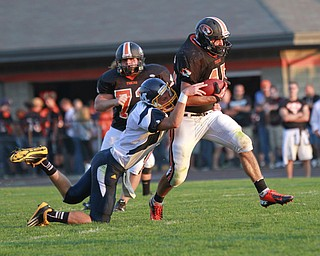 ROBERT  K.  YOSAY  | THE VINDICATOR --..BIG MOVER as Springfields #45 Chris Wells  drags along McDonalds #2 Christian Rusinowski -  as he rambled for a first down and then some - during first quarter action..McDonald @ Springfield - Game was at New Springfield...(AP Photo/The Vindicator, Robert K. Yosay)