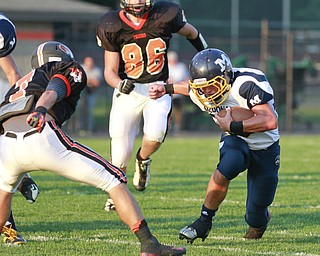 ROBERT  K.  YOSAY  | THE VINDICATOR --..McDonalds #36  Cody Colburn makes a cut during first quarter action on Springfields #7 Anthony Scandy  as # 86 Mark Schuler -..McDonald @ Springfield - Game was at New Springfield...(AP Photo/The Vindicator, Robert K. Yosay)