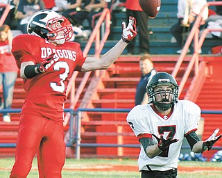 Niles' Aaron Watson (3) breaks up a pass intended for Girard's Collin Cramer(7) during the first quarter of Thursday's game in Niles. The Red Dragons downed the Indians, 34-13.