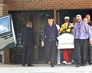 Pall-bearers carry Bryce Linebaugh's coffin from Leavittsbur Church of God Friday, Aug. 24, 2012.