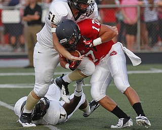 ROBERT  K.  YOSAY  | THE VINDICATOR --..Fitchs #17  Tyler Grover is caught for a loss  by Hardings 51 Steven Ainsley and #7  Mik'Quan Dorsey during first quarter action..Warren Harding @ Austintown Fitch -Fitch Stadium...(AP Photo/The Vindicator, Robert K. Yosay)