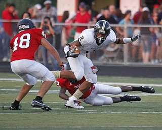 ROBERT  K.  YOSAY  | THE VINDICATOR --..Hardings #2  Jalyn Powell  cuts inside Fitchs #48  Cameron Rezpourian as he breaks the grip of #9  fitch  Keith Lawrence -  during first half action..Warren Harding @ Austintown Fitch -Fitch Stadium...(AP Photo/The Vindicator, Robert K. Yosay)