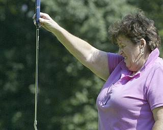 William D Lewis The Vindicator Lori Bowden lines up a putt Friday at Mill Creek.