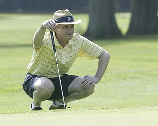 William D Lewis The Vindicator  Dominic Fabiilli lines up a putt Friday at Mill Creek.