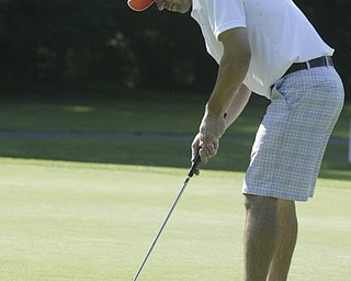 William d Lewis the vindicator Buzz Papalia sinks a putt Friday at Mill Creek.