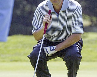 William D Lewis The Vindicator Dr. James LaPolla lines up a putt Friday at Mill Creek.