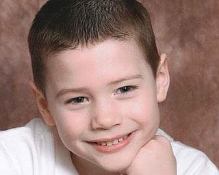 Bryce Linebaugh, 8, shot to death while sleeping in his second-floor bunkbed. The bullets came from a gunman shooting into Bryce's East Side Youngstown apartment building.