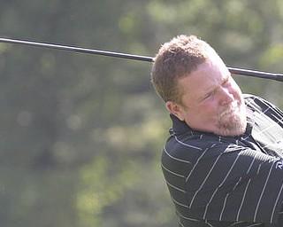 William D Lewis The Vindcator Dan Stanton tees off at Trumbull Saturday.