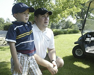 William D. Lewis The Vindicator  In the gallery at Trumbull CC Saturday are Nick Odille and his son Ian, 5.