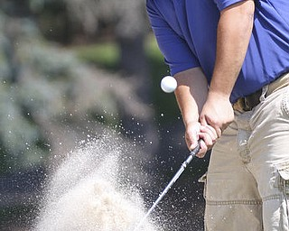 William D Lewis the Vindicator  Bill Vrontos blasts out of a bunker at YCC Saturday.