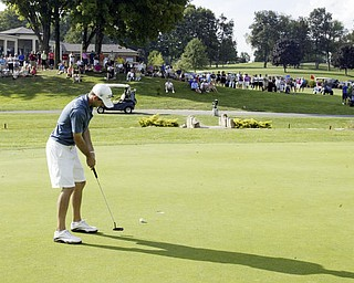 William D. Lewis The Vindicator  Anthony Conn winner of open division golf  puts on finalgreen at Lake Club Sunday.