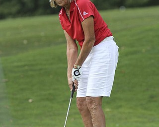 William D. Lewis The Vindicator Marilyn woods putts at Lake Club Sunday.