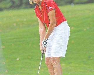 Marilyn Woods of Oak Tree Country Club putts during the final round of the 2012 Greatest Golfer of the Valley tournament Sunday at The Lake Club in Poland. Woods shot a 95 for the day and a 267 for the tournament to earn the title of Greatest in the Women's 9-Plus Handicap Division.