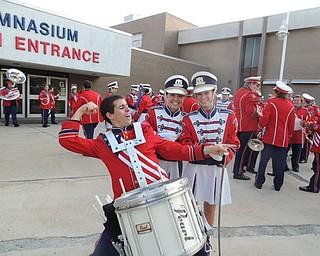 Color guard captains Kayla Bailey and Julie Larkin with Drumline captian Ryan McBride pregame
