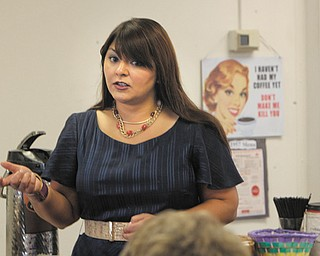 State Sen. Capri Cafaro of Liberty, D-32nd, gives a state legislative update to visitors at the Girard Multi-Generational Center. Cafaro spoke Monday, answering questions about pension reform for retired state workers and informing members about state issues.