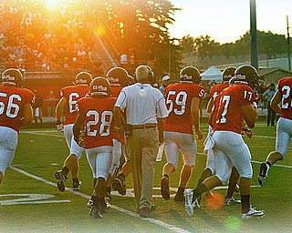 Austintown Fitch Coach Annarella - #56 Mike Koch, #28 - Tyreese Anderson, #59 - Matt Mullins, #17 Tyler Grover, #20 Jared McHenry with one of the starting plays