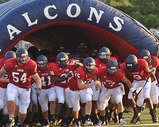 Austintown Fitch players coming out of the tunnel in front - #54 Billy Price, #41 Andrew James, #15 Matt Futkos, #17 Tyler Grover, #9 KJ Lawrence