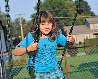 Morganne Evans, 7, has stabilized her weight with a combination of physical activity and healthy food choices. Examples are fruits and vegetables for snacks instead of chips and smaller portions.