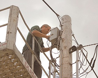 Dave Peters of Enhanced Network Solutions makes the final wireless Internet hookups at the Canfield Fairgrounds' trailer park. Beginning today, those staying at the trailer park will be able to purchase Internet access for $10 per day or $30 for the entire six days. Timm Schreiber, fair board member, said if all goes well this year they will look into making the entire fairgrounds wireless.