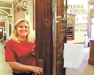 Kathy Petrella, a longtime worker in the county clerk of courts office, will retire before changes are made in the Ohio Public Employee Retirement System that would affect her health care.