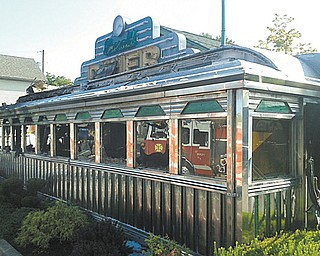 The Emerald Diner in Hubbard was severely damaged by a fire Tuesday morning. The train car-turned-restaurant opened in 1994 after owner James P. Marsh brought the 1939 car from Connecticut and transported it to its location on North Main Street. The cause of the fire remains under investigation.