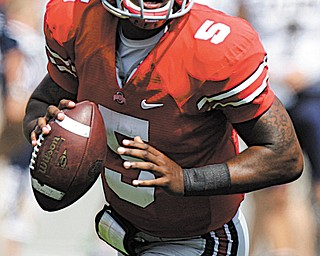 Ohio State quarterback Braxton Miller looks to throw during a game against Akron last season in Columbus.