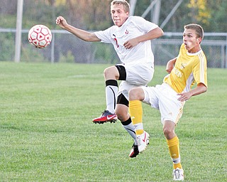 Cardinal Mooney's Michael Trefethern (12) and Massillon Jackson's Patrick Zonfa (9) go for the ball Tuesday at Valley Sports. Below: Mooney's Nicholas Koken (3) and Jackson's Grant Slovan (19) battle for the ball. Jackson won, 5-0.