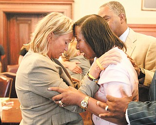 Rebecca Doherty, chief of the criminal division of the Mahoning County Prosecutor's office, left, and Shirlene Hill, mother of murder victim Jamail Johnson, embrace after a jury on Wednesday convicted Columbus Jones Jr. on all counts.