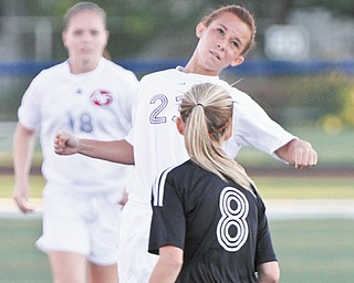Fitch's Maddy Miller (23) uses her head to keep the ball away from Struthers' Nicole Johnson (8) during their soccer match Wednesday at Fitch High School in Austintown. The Falcons dominated the Wildcats, 11-0.