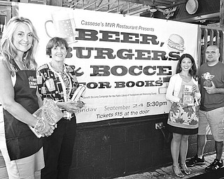 """From left, Debbie Liptak, development director for the Public Library; Julie Costas and Natalie Lariccia, committee members; and Joe Cassese, manager of Cassese's MVR; are among those planning the """"Beer, Burgers and Bocce"""" library fundraiser. Photo by MADELYN P. HASTINGS 