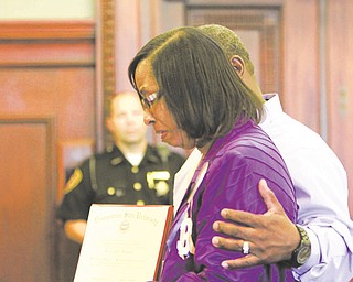 Shirlene Hill, mother of murder victim Jamail Johnson, is comforted by her husband Sydney Hill as she makes a tearful impact statement to the court during the sentencing of her son's killer, Columbus Jones Jr. Mr. Hill held Jamail's diploma from Youngstown State University, which was awarded posthumously.