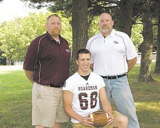 There will be more than a rivalry on the field at tonight's Boardman-Mooney game. Brothers Doug Velasquez, left, and Tom Velasquez, far right, will face off on opposing sidelines, with Doug serving as defensive assistant for the Spartans, and Tom sharing defensive coordinator duties for the Cardinals. Making things more interesting is that their nephew, Ryan Ebie, center, is a defensive tackle with the Spartans.