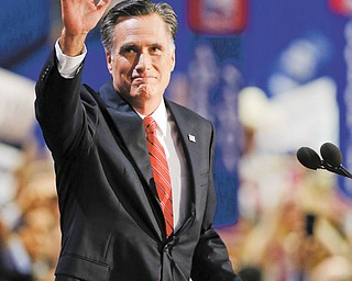 Presidential nominee Mitt Romney waves to delegates before speaking at the Republican National Convention in Tampa, Fla., on Thursday.
