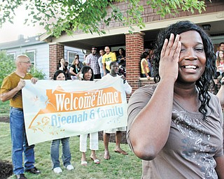 Ajeenah Seifullah is overcome with joy Thursday evening after being presented with a surprise: a house for her family. The house on East Florida Avenue in Youngstown was donated by a church member, and other members from Victory Christian Center in Liberty helped to fix it up.