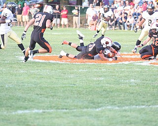 NICK MAYS l THE VINDICATOR.(41) Ralph Robinson of Howland and (7) Mik'quan Dorsey of Harding fight for the ball on the opening kick off   in Howland. - harding vs howland at howland  Friday 08312012
