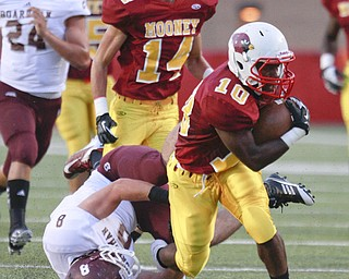 ROBERT K. YOSAY  | THE VINDICATOR..Mooneys #10   Justus Ellis-Moore   breaks through the line and Bdm#8 Ryan Savage  as Mooney #14  Marcus Penza Looks on -  he gained  a first down and 35 yards during first quarter action..Bdm @ Mooney - Stambaugh Stadium... - -30-..