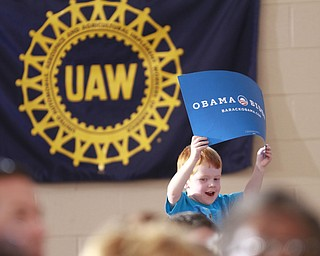 ROBERT  K.  YOSAY  | THE VINDICATOR --..BIG supporter as  John Hughes Jr of Austintown 4 was there with his mom and dad  John Sr. and Nicole - .Vice President Joe Biden made several stops in the area on Friday as he stopped in the  UAW  1714  Mocha House and the Canfield Fair...(AP Photo/The Vindicator, Robert K. Yosay)