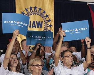 ROBERT  K.  YOSAY  | THE VINDICATOR --..Hearty supporter - front row...  Cathy McGowan of Hubbard - Mary Sue  Lazac of  Mineral Ridge and Mike Wisor of McDonald ---Vice President Joe Biden made several stops in the area on Friday as he stopped in the  UAW  1714  Mocha House and the Canfield Fair...(AP Photo/The Vindicator, Robert K. Yosay)