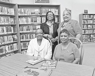 Among those planning the Delta Sigma Thetas' Tribute to Black Excellence event are, seated from left, Michele Dotson, chairwoman, and Gwen Montgomery, and standing from left, Charlotte Grant and Nikki Davis.  Photo by: ROBERT K. YOSAY | THE VINDICATOR
